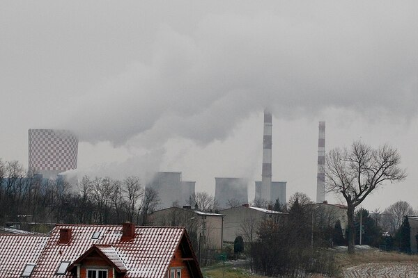 In this Nov. 21, 2018 photo smoke billows from chimney stacks of the heating and power plant in Bedzin, near Katowice, southern Poland. Katowice, in the southern coal mining region, will host global climate summit Dec.2-14. (AP Photo/Czarek Sokolowski)