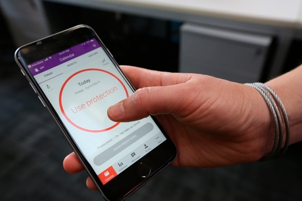 A women demonstrates using the Natural Cycles smartphone app, in London, Friday, Aug. 17, 2018. The mobile fertility app, has become the first ever digital contraceptive device to win FDA (US Food and Drug Administration) marketing approval, enabling women to track their menstrual cycle and uses an algorithm to determine when they're fertile, and need to use birth control protection. (AP Photo/Nishat Ahmed)