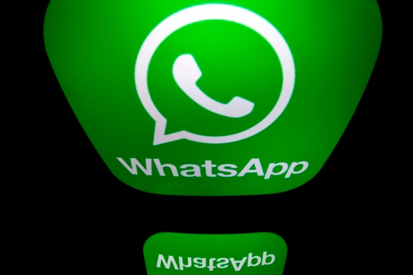 (FILES) In this file photo taken on December 28, 2016 a picture taken in Paris shows the logo of WhatsApp mobile messaging service. - WhatsApp on January 15, 2021 delayed a data-sharing change as users worried about privacy fled the Facebook-owned messaging service and flocked to rivals Telegram and Signal.