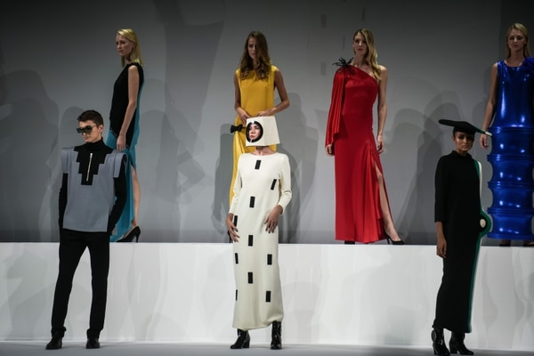 Models pose with Pierre Cardin's creations during an event marking the 70 years of career of French fashion designer Pierre Cardin at the Theatre du Chatelet in Paris, on September 21, 2020. (Photo by Lucas Barioulet / AFP)