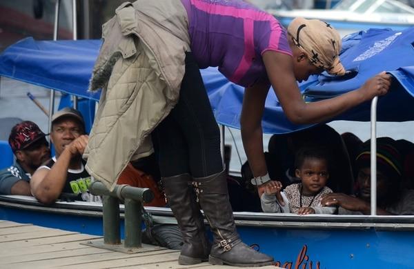 Migrantes haitianos se preparaban para viajar a través del golfo de Urabá, en el noroeste de Colombia, para dirigirse hacia Panamá. Ocurrió en agosto del 2016.
