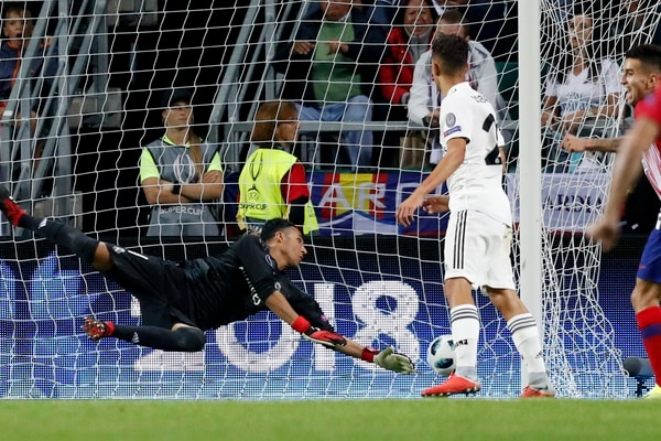 Real Madrid's goalkeeper Keylor Navas fails to make a save during the UEFA Super Cup final soccer match between Real Madrid and Atletico Madrid at the Lillekula Stadium in Tallinn, Estonia, Wednesday, Aug. 15, 2018. (AP Photo/Pavel Golovkin)