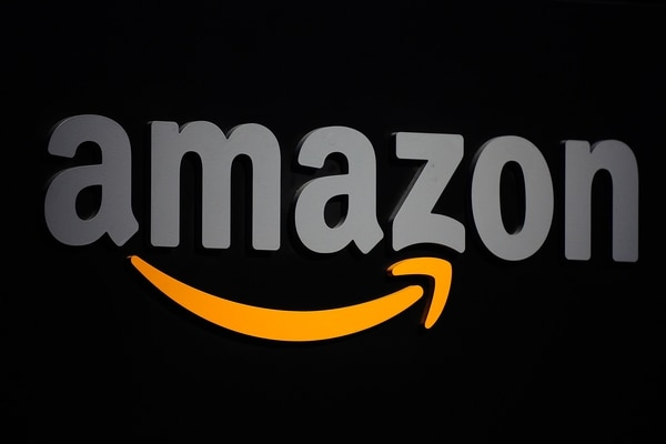 (FILES) In this file photo taken on September 28, 2011, the Amazon logo is seen on a podium during a press conference in New York. - Amazon on November 21, 2018, said that a website glitch accidentally exposed names and email addresses of some of the e-commerce giant's customers. Amazon declined to disclose the extent of the software slip-up.