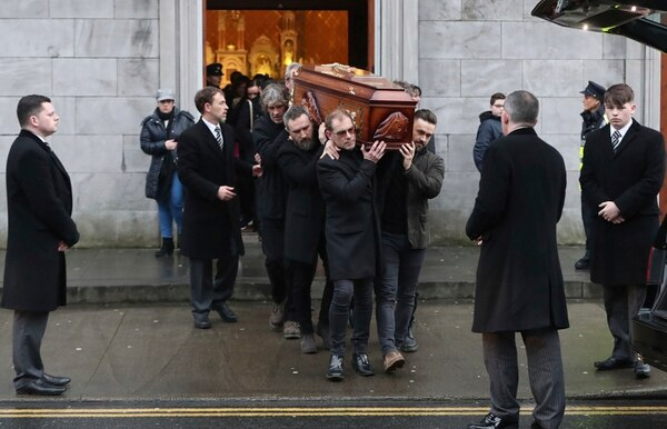 The coffin of Cranberries singer Dolores O'Riordan is removed from St Joseph's Church in Limerick, Ireland, Sunday, Jan. 21, 2018. O'Riordan, 46, was found dead Monday morning at a London hotel. (Niall Carson/PA via AP)