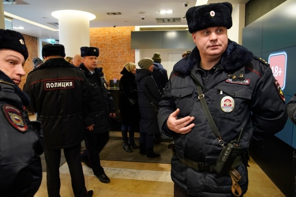Russian police visit the Pioner movie theater in Moscow, Russia, Friday, Jan. 26, 2018. Pioner movie theater has been showing Scottish writer-director Armando Iannucci's