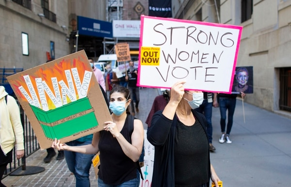 Demonstrators rally as they take part in the nationwide Women's March on October 17, 2020, in New York City. (Photo by Kena Betancur / AFP)