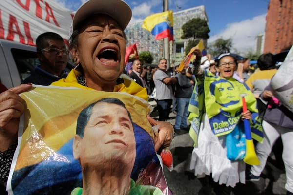 Supporters of former President Rafael Correa protest outside of the Supreme Court in Quito, Ecuador. Monday, June 18, 2018. The Court linked the former in a criminal proceeding for the kidnapping of a opponent in Colombia in 2012. Correa currently resides in Belgium. (AP Photo/Dolores Ochoa)