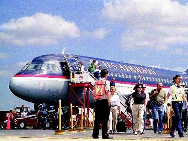 US Airways es una de las aerolíneas que vuelan desde Charlotte (Carolina del Norte) al Daniel Oduber, en Liberia. Esta terminal se ha convertido en una importante puerta para turistas que buscan las playas guanacastecas.   ARCH.