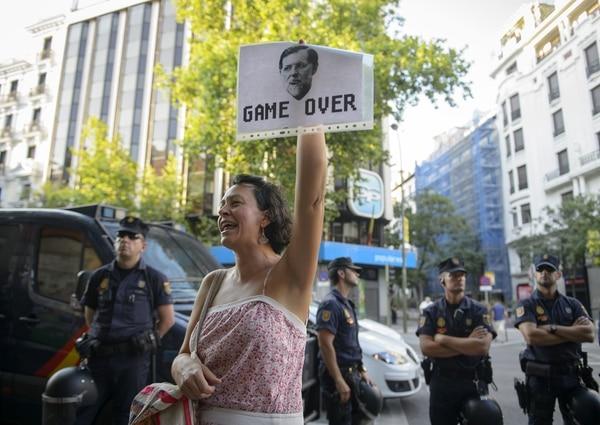 Esta mujer protestó, en julio del 2013, contra la supuesta corrupción de altos dirigentes del Partido Popular. Lo hizo frente a la sede de esta organización en Madrid.