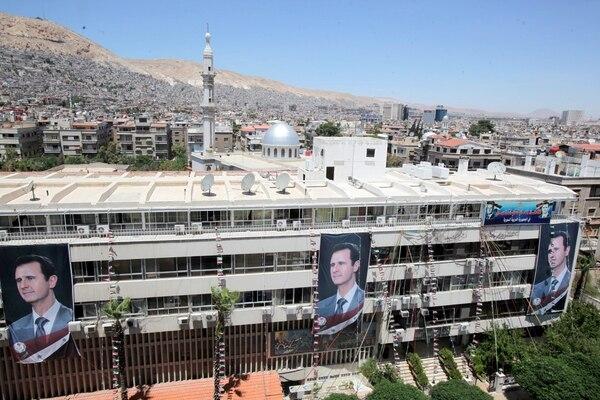 Ciudad de Damasco en Siria se encuentra cubierta con propaganda electoral, al mismo tiempo que se desatan actos de violencia.