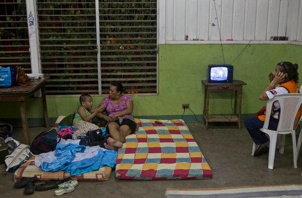Algunos residentes de Managua fueron llevados a refugios. | AFP