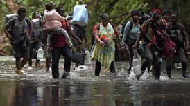 (Fotos) Asaltos, estafas y violaciones: Así es el viaje de los haitianos por la selva colombiana del Darién