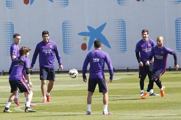 Los jugadores del FC Barcelona Thomas Vermaelen, Luis Suárez, Leo Messi y Javier Mascherano, durante el entrenamiento del equipo en la Ciudad Deportiva Joan Gamper.
