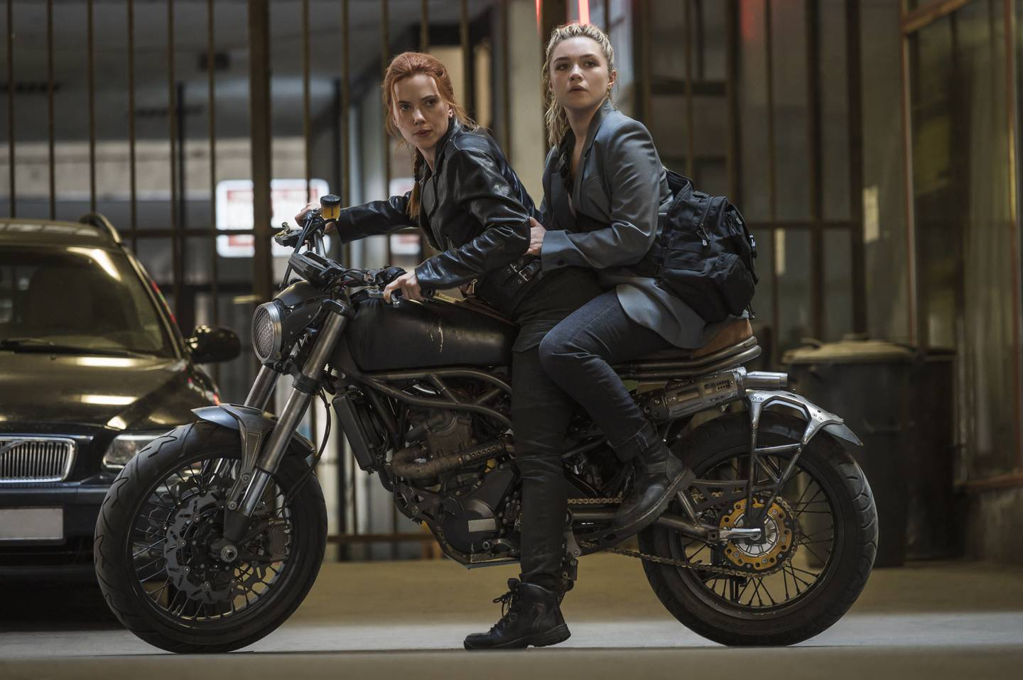 Scarlett Johansson as Black Widow/Natasha Romanoff and Florence Pugh as Yelena in Marvel Studios' BLACK WIDOW. Photo by Jay Maidment. ©Marvel Studios 2020. All Rights Reserved.