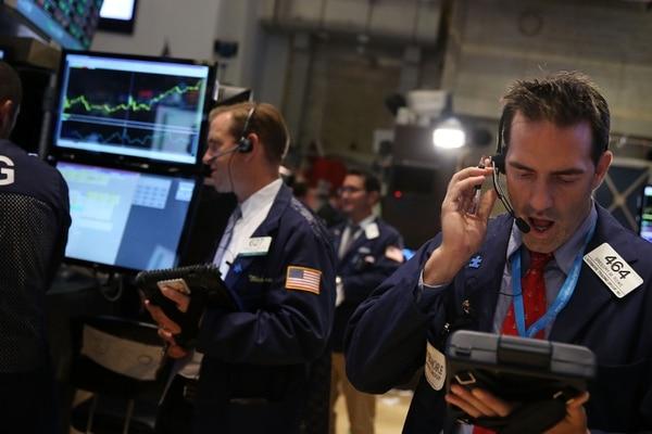 Traders trabajaban en la Bolsa de Nueva York, este viernes.