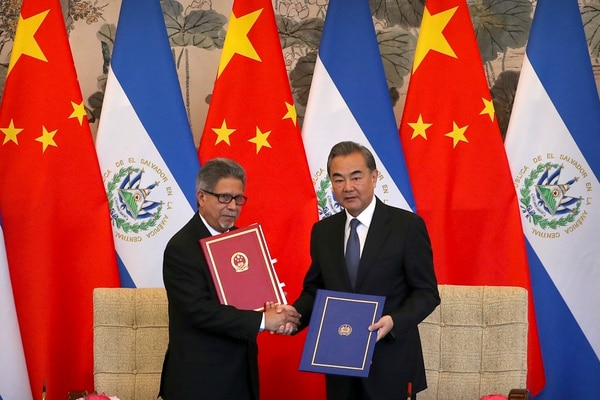 In this Tuesday, Aug. 21, 2018, file photo, El Salvador's Foreign Minister Carlos Castaneda, left, and China's Foreign Minister Wang Yi shake hands at a signing ceremony to mark the establishment of diplomatic relations between the two countries at the Diaoyutai State Guesthouse in Beijing. Taiwan broke off diplomatic ties with El Salvador on Tuesday as the Central American country defected to rival Beijing in the latest blow to the self-ruled island China has been trying to isolate on the global stage. (AP Photo/Mark Schiefelbein, File)