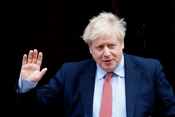 (FILES) In this file photo taken on March 25, 2020 Britain's Prime Minister Boris Johnson leaves number 10 Downing Street in central London on March 18, 2020, on his way to the House of Commons to attend Prime Minister's Questions (PMQs) - British Prime Minister Boris Johnson was taken to hospital on April 5, 2020 for tests, his office said, 10 days after he tested positive for coronavirus. Johnson, 55, announced he had mild symptoms of COVID-19 on March 27 and had been in self-isolation at his Downing Street residence for seven days. (Photo by Tolga AKMEN / AFP)