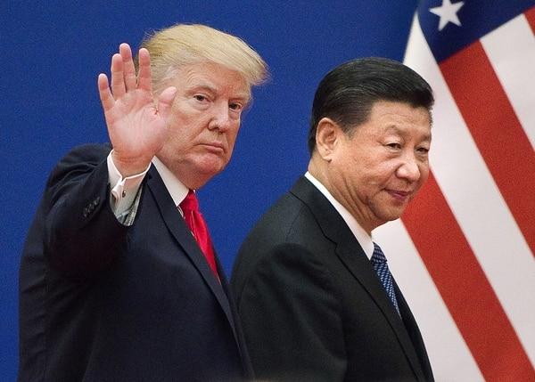 El presidente Donald Trump y su homólogo chino, Xi Jinping, decretaron una tregua en la guerra comercial que habían estado librando durante meses. Foto de archivo. AFP