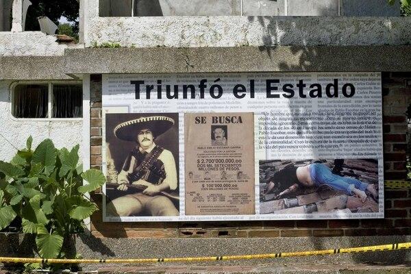 Muy explícito es el letrero que dice a los turistas en Hacienda Nápoles que Colombia venció a tiros a Pablo Escobar, quien fuera su enemigo más enconado.