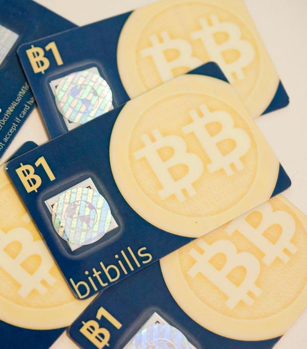 El Bitbill es una representación física de la Bitcoin. Especialistas cuestionan si el alza de precio de la moneda es real, o una burbuja.   N. PALMIERI/NYT