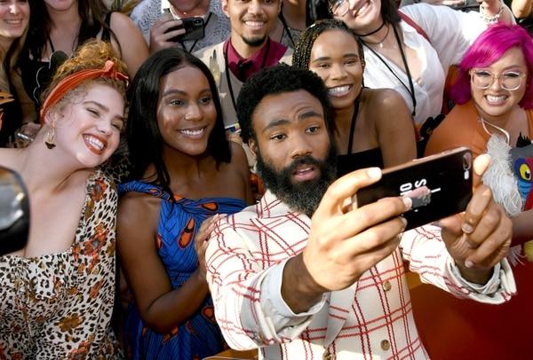 Donald Glover, también conocido en su faceta de cantante como Childish Gambino, interpreta a Simba. Foto: Kevin Winter/Getty Images/AFP