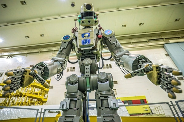 This handout picture taken on July 26, 2019 and released by the official website of the Russian State Space Corporation ROSCOSMOS on August 21, 2019 shows Russian humanoid robot Skybot F-850 (Fedor) being tested ahead of its flight on board Soyuz MS-14 spacecraft at the Baikonur Cosmodrome in Kazakhstan. - Russia space agency Roscosmos is about to send a humanoid robot to the International Space Station. Skybot F-850 will be sent to the ISS on August 22 on board the Soyuz MS-14 spacecraft, and will spend over two weeks there before returning to Earth on September 7. It's the first time that a robot will take the commander's place in a Soyuz � the Skybot will monitor and report on conditions during the otherwise uncrewed flight. (Photo by - / Roscosmos space agency / AFP) / RESTRICTED TO EDITORIAL USE - MANDATORY CREDIT