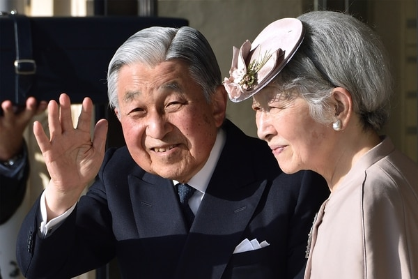Japan's Emperor Akihito (L) and Empress Michiko (R) wave to well-wishers before leaving Ujiyamada Station after their visiting Ise Jingu shrine in Ise in the central Japanese prefecture of Mie on April 18, 2019, as Emperor Akihito takes part in a series of rituals ahead of his abdication. - Akihito will step aside and make way for his son Crown Prince Naruhito on April 30. (Photo by Kazuhiro NOGI / POOL / AFP)
