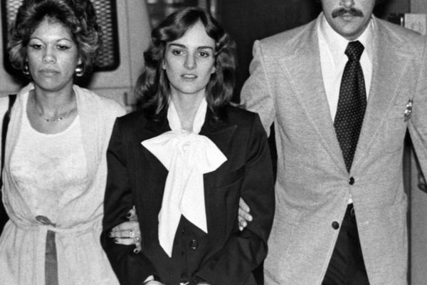U.S. marshals escort Patricia Hearst from San Francisco's Federal Building on Feb. 3, 1976, where jury selection continued in her bank robbery trial. Photo Credit: AP