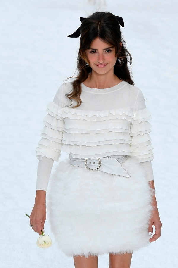 Spanish actress Penelope Cruz presents a creation by Chanel during the Women's Fall-Winter 2019/2020 Ready-to-Wear collection fashion show at the Grand Palais turned into a wintry village in Paris, on March 5, 2019. (Photo by Christophe ARCHAMBAULT / AFP)
