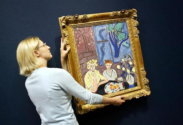 La pintura de Henri Matisse no era bien vista por el régimen nazi. Esta obra (no es parte del lote hallado), Deux filletts fond gris, fenetre bleue , se ofreció en la casa de subastas Christies, en Londres, en el 2004. | AFP