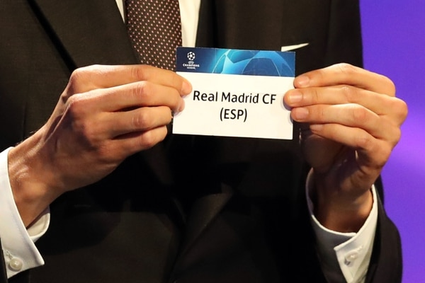 Brazilian former football player Kaka shows the name of Real Madrid during the draw for UEFA Champions League football tournament at The Grimaldi Forum in Monaco on August 30, 2018. (Photo by Valery HACHE / AFP)