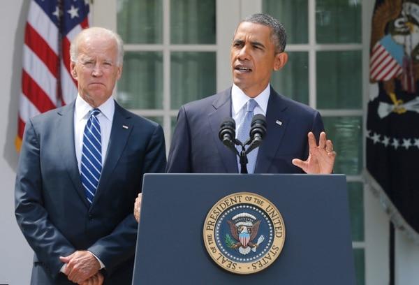 Barack Obama junto al vicepresidente Joe Biden anuncia su decisión de atacar Siria, pero antes consultará al Congreso