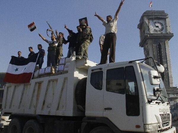 Las fuerzas de Bashar al-Asad tomaron ayer la estratégica ciudad de Cuseir. | AFP.