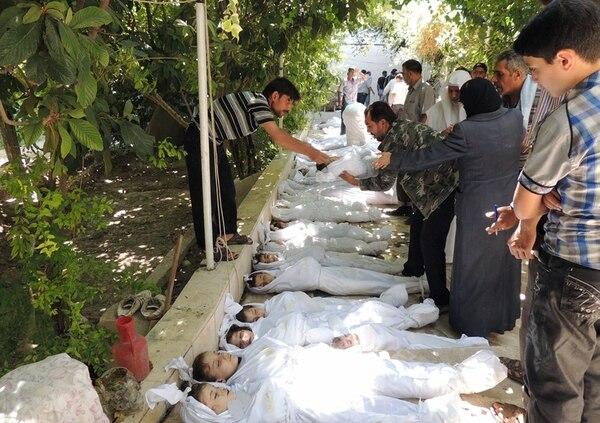 Imágenes como esta de agosto, de un ataque químico en Siria, conmovieron al mundo entero, más aún porque muchas de las víctimas eran niños. | FOTO: AFP