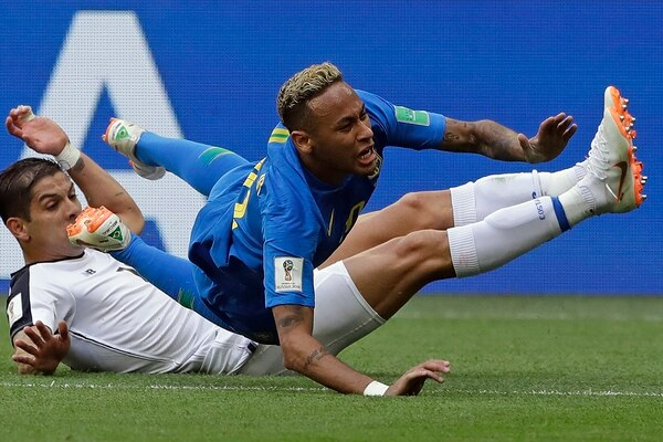 Brazil's Neymar is brought down by Costa Rica's Cristian Gamboa during the group E match between Brazil and Costa Rica at the 2018 soccer World Cup in the St. Petersburg Stadium in St. Petersburg, Russia, Friday, June 22, 2018. (AP Photo/Andre Penner)
