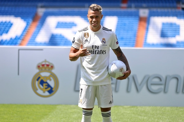 Newly signed Real Madrid soccer player Mariano Diaz poses for the media during his official presentation for Real Madrid at the Santiago Bernabeu stadium in Madrid, Friday, Aug. 31, 2018. (AP Photo/Andrea Comas)