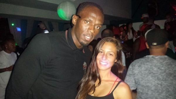 Usain Bolt departió con la diseñadora gráfica Jenny Vega