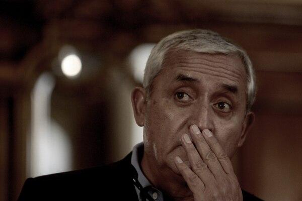 El presidente Otto Pérez Molina se refirió el viernes, en conferencia de prensa, al escándalo por contrabando y defraudación tributaria. Excluyó responsabilidad suya y de su gobierno en el caso. | EFE
