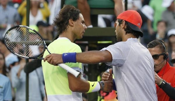 Fernando Verdasco (der.) saluda a Rafael Nadal tras ganarle en el Masters 1000 de Miami.