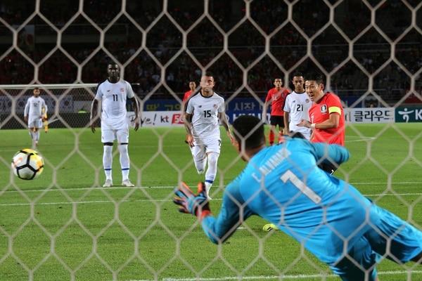 South Korea's Son Heung-min kicks a penalty shot as Costa Rica's goalkeeper Esteban Alvarado looks on during their friendly soccer match in Goyang, South Korea, Friday, Sept. 7, 2018. (AP Photo/Ahn Young-joon)