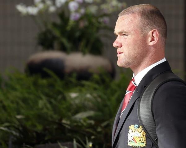 Rooney en su llegada al aeropuerto de Bangkok. | EFE.