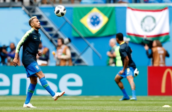 Brazil's Neymar kicks a ball as he warms-up with teammates ahead of the group E match between Brazil and Costa Rica at the 2018 soccer World Cup in the St. Petersburg Stadium in St. Petersburg, Russia, Friday, June 22, 2018. (AP Photo/Alaistair Grant)