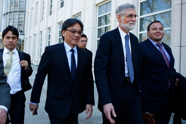 Eduardo Li(2ndL) of Costa Rica, leaves the Court of the Eastern District in Brooklyn New York on April 13, 2016. The US federal judge overseeing the sweeping FIFA corruption scandal said Wednesday that he would rule within days whether to set a date for trial while evidence still pours in. The legal team of Costa Rica's Eduardo Li proposed at least a one-month delay, estimating that the amount of data in the case ranged from 700 million to 900 million pages. / AFP PHOTO / KENA BETANCUR