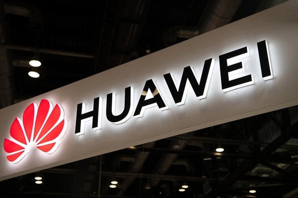 (FILES) This file photo taken on August 2, 2019 shows the Huawei logo during the Consumer Electronics Expo in Beijing. - Chinese tech giant Huawei said on October 16, 2019 that its revenue for the first nine months of the year grew 24.4 percent year-on-year despite a US campaign to isolate the company globally. (Photo by Fred DUFOUR / AFP)