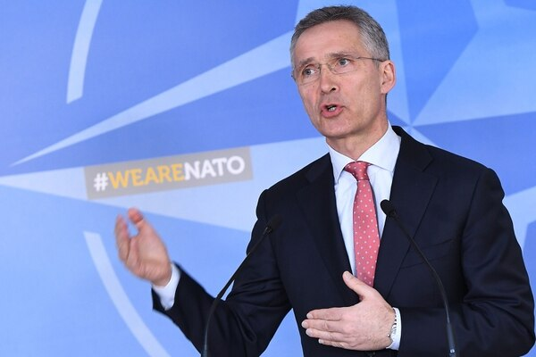 NATO Secretary General Jens Stoltenberg addresses the press at NATO headquarters in Brussels on March 27, 2018. Stoltenberg said on March 27, 2018, the alliance was expelling seven Russian diplomats and denying accreditation to three more as part of international measures over the poisoning of a former spy in Britain. / AFP PHOTO / Emmanuel DUNAND