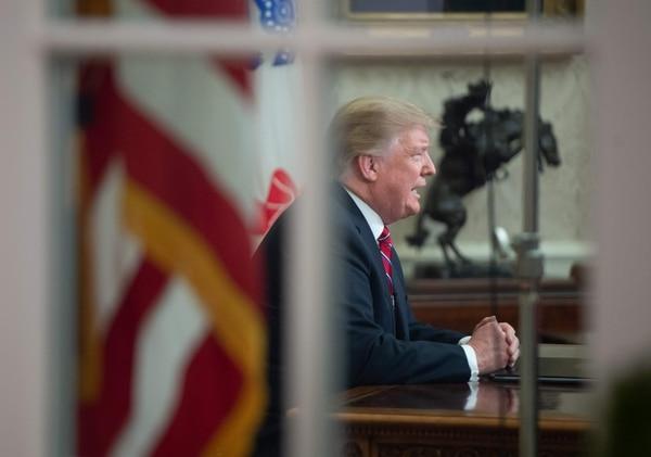 El presidente de Estados Unidos, Donald Trump, pronunció un discurso para presionar sobre la financiación de un muro fronterizo con México, el 8 de enero del 2019. Foto: AFP
