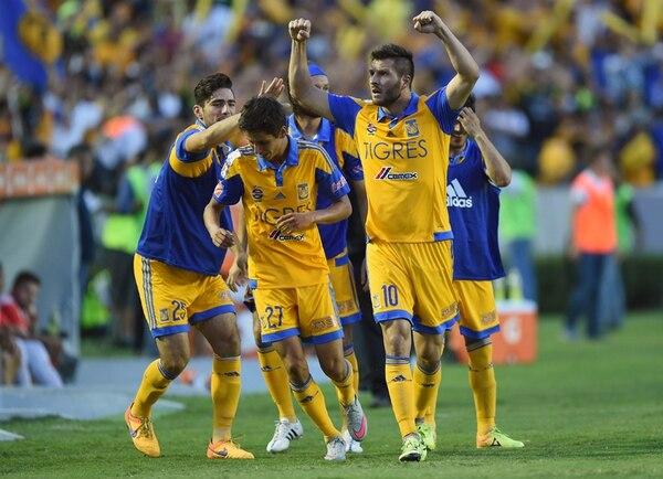 Andre Guignac (10) anotó el primer gol de Tigres, ayer. | AFP