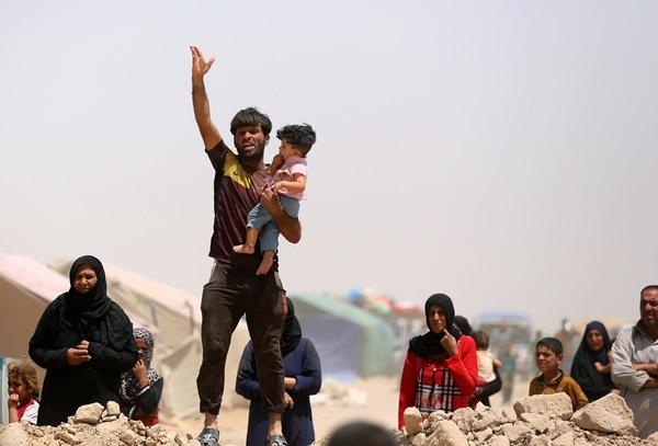 Fuerzas iraquíes mantienen posiciones en el área de Jurf al-Sakher, 50 km al sur de Bagdad, para evitar posibles avances del Estado Islámico (EI). Hay preocupación internacional por las conquistas del grupo. | AFP