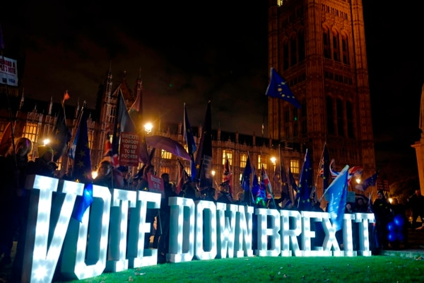 Anti-Brexit demonstrators protest outside Parliament with a giant