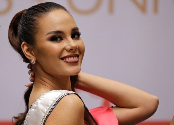 Miss Universe 2018 Catriona Gray from the Philippines poses for photographers during a press conference in metropolitan Manila, Philippines Thursday, Dec. 20, 2018. Gray is in the country for a short visit to attend to a charity event at an orphanage before flying to the U.S. (AP Photo/Aaron Favila)